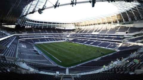 Spurs warned over Champions League stadium advert