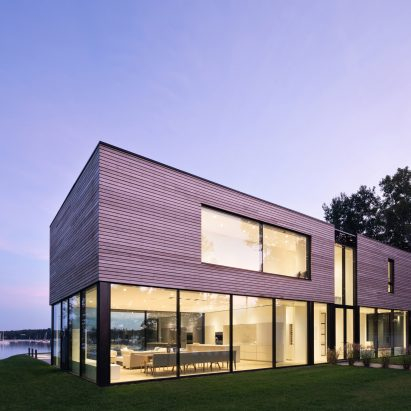 Glass surrounds lower level of Teph Inlet house by Omar Gandhi Architect
