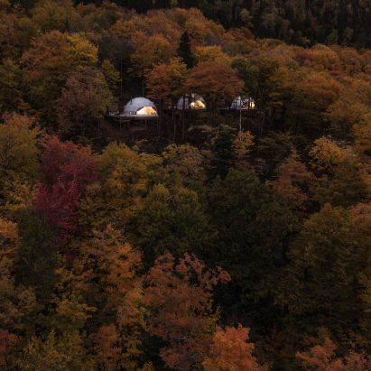 Eco-luxury domes by Bourgeois/Lechasseur peer from Quebec forest