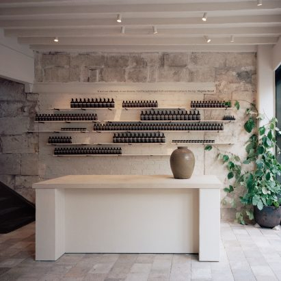 Local architecture informs stone-clad interiors of Aesop store in Bath