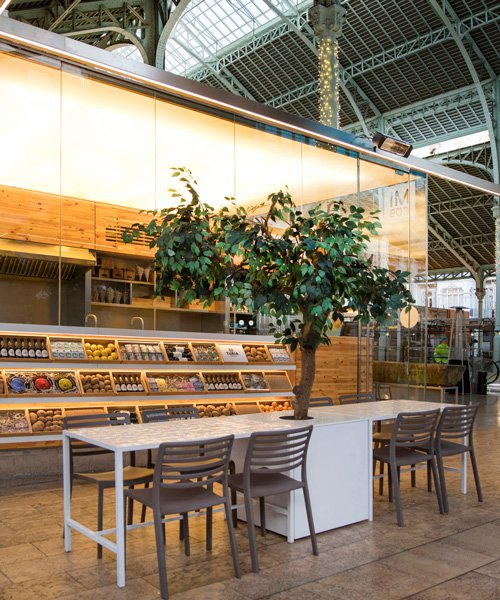 micub restaurant by culdesac references the traditional baskets of valencia's colón market