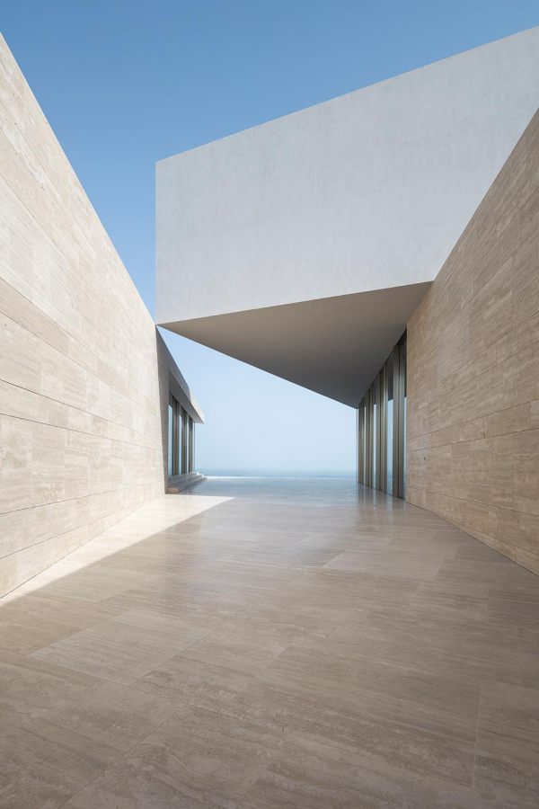 Bahraini architect Jalal AlNajjar designs a monolithic guest house in the Persian Gulf