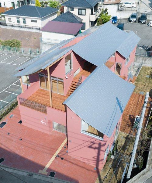 tomoyuki kurokawa tops pink-hued nursery school with a curved roof of laminated wood
