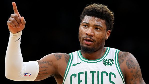 Celtics guard Marcus Smart squares up and blocks Heat center Bam Adebayo's dunk (video)