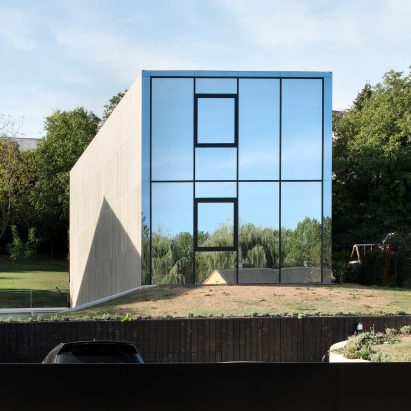 2001 creates concrete house and reflective glass house in suburban Luxembourg