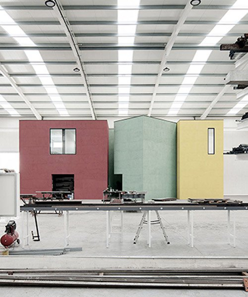 martins architecture office constructs large reflective warehouse in portugal