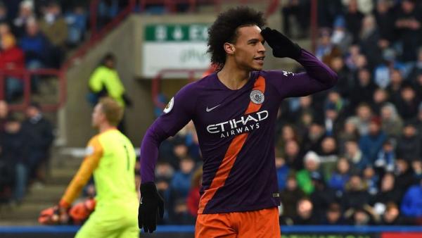 Man City breeze past Huddersfield