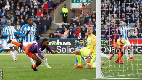 Man City score their 100th goal of season to beat managerless Huddersfield