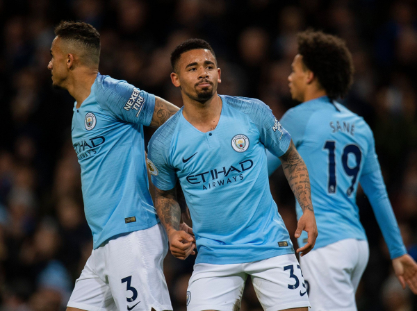 Manchester City maintain pressure on Premier League leaders Liverpool with easy win over 10-man Wolves