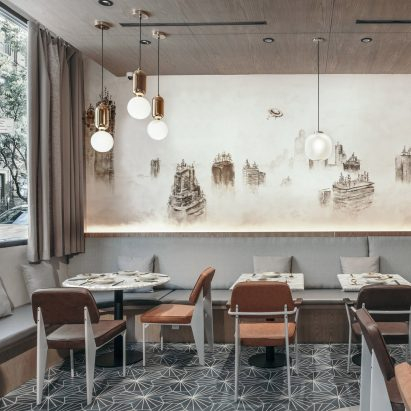 New Practice Studio uses desaturated palette and Chinese imagery at Atlas Kitchen