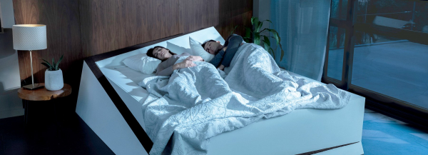 ford's smart bed rolls selfish sleepers back to their own side
