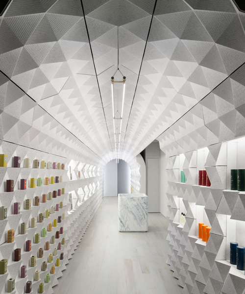 tacklebox contains claus porto's new york store within a freestanding archway