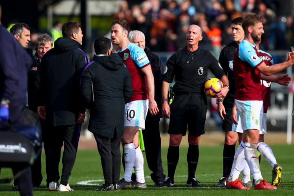 Mauricio Pochettino squares up to Mike Dean after Spurs' defeat to Burnley
