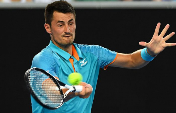 Tomic sets up Isner clash at New York Open