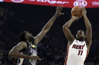 Cousins' late free throws lead Warriors past Heat 120-118