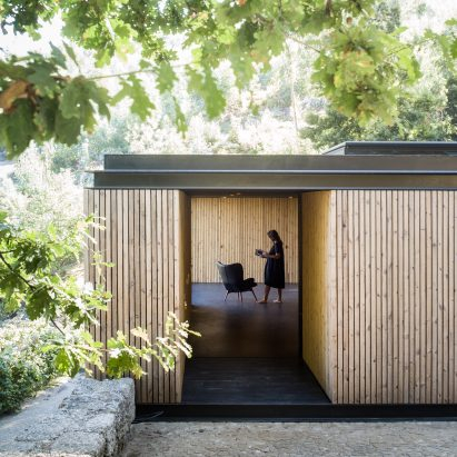 Timber walls disguise secret spaces within tiny Pavilion House in Portugal