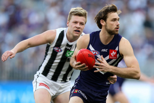 Dockers duo sign on