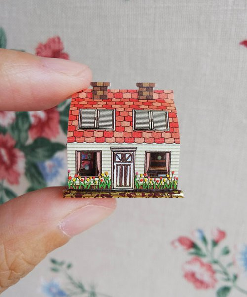 miniature pop-up books hold beds and staircases smaller than fingernails