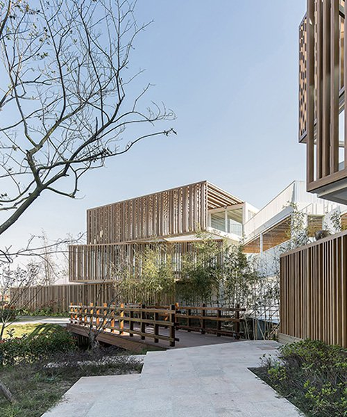 yiduan shanghai adds timber canopy to shipping containers to form office