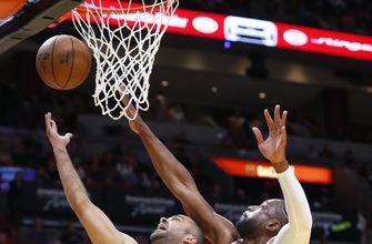 Dragic, Wade lead Heat past Hornets, 93-75