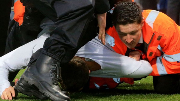 Five charged for Newcastle pitch invasion