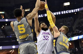 Towns has 33 points, 23 boards to lift Wolves over Memphis