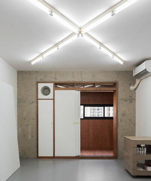 archive transforms artist's shanghai apartment into painter's quarters