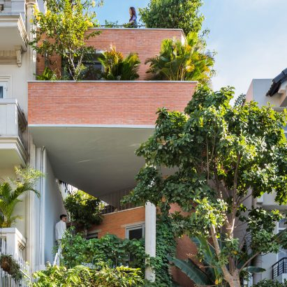 Garden terraces link living spaces in Ha House by Vo Trong Nghia Architects