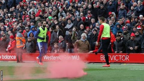 Police investigate Anfield flare incident