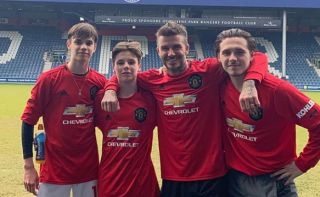 Image result for images of Football legend, David Beckham and his three sons pose in new Manchester United jerseys