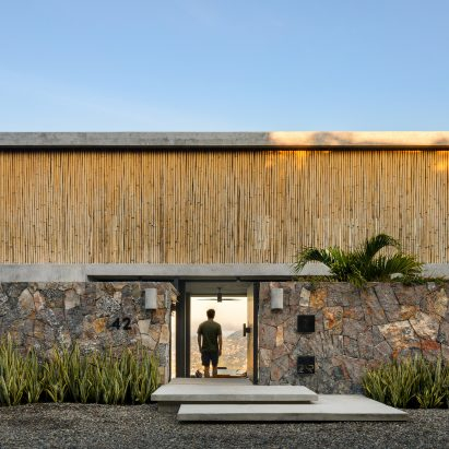 Bamboo screen fronts minimal home in Mexico's West coast by Zozaya Arquitectos