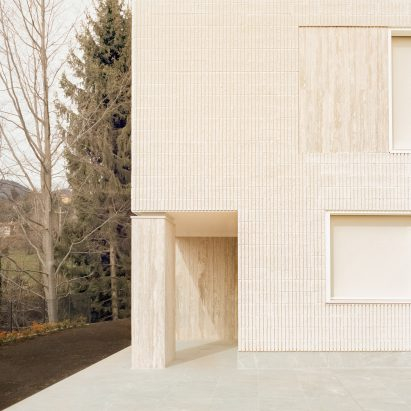 """LCA Architetti models """"primitive"""" House of the Archeologist on fossils"""