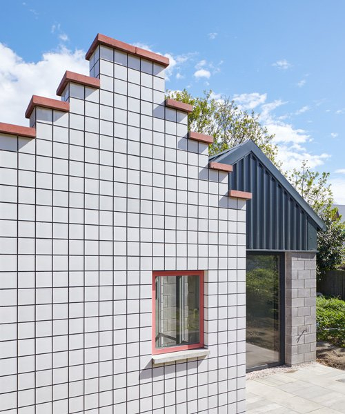 this artist's studio in london is hidden behind two distinctive gabled façades
