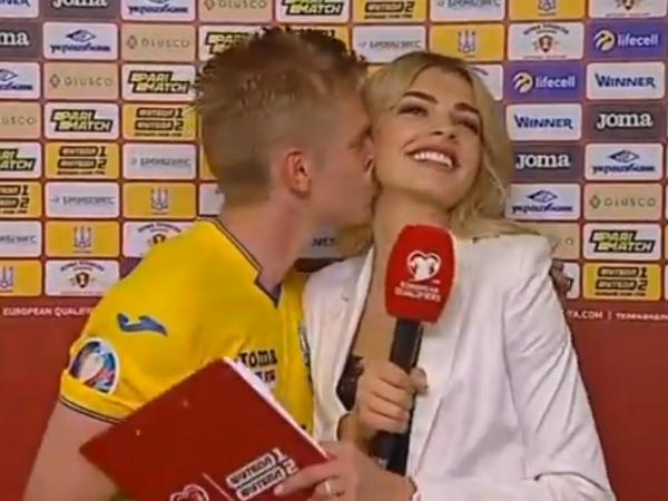 Manchester Citys Oleksandr Zinchenko kisses Ukrainian reporter on live TV after victory over Serbia