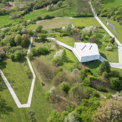 Robert Konieczny folds white concrete road around house in Poland