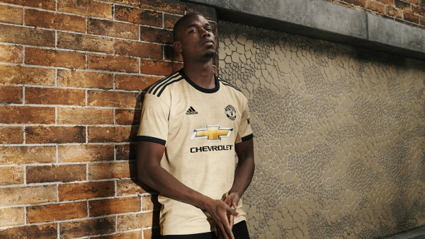 Pogba models new Manchester United away kit as Real Madrid links continue