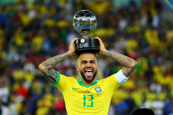 Dani Alves says his next club will be signing a 'true champion' amid Arsenal transfer rumours