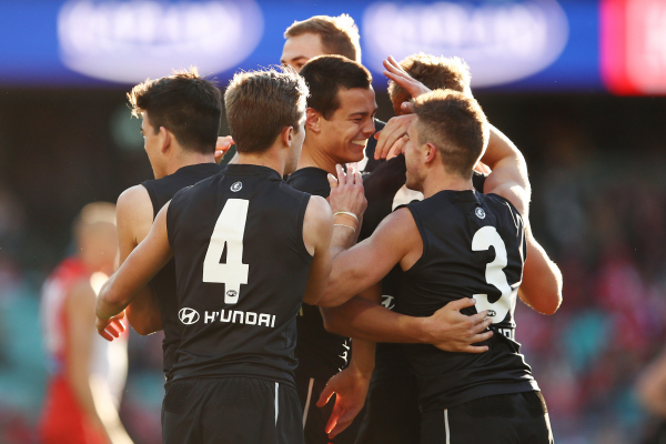 AFL: Some 'Tippa' magic gets Bombers home against Kangaroos