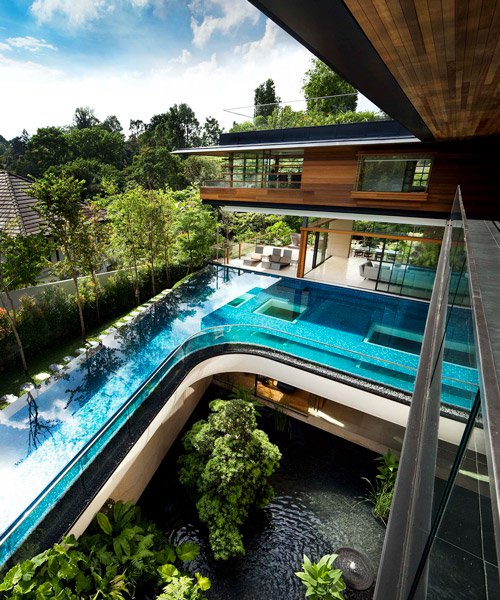 guz architects cantilevers the 'botanica' house over the lush nature of singapore