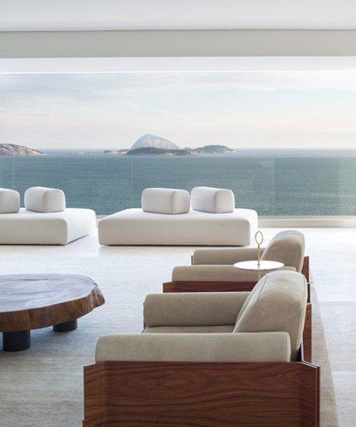arthur casas frames rio de janeiro views in sophisticated apartment