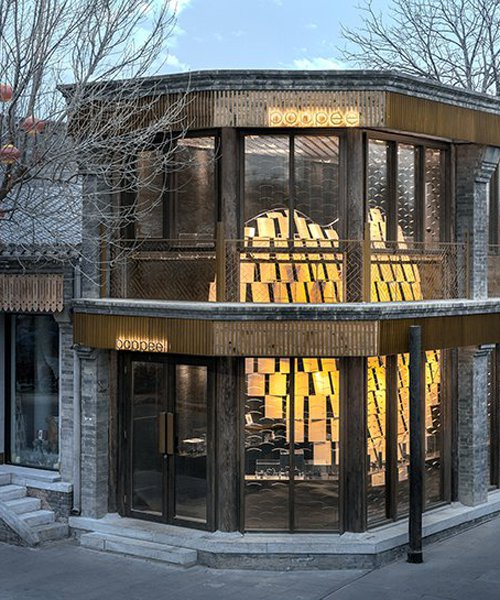 atelier tree brings life to beijing storefront with golden heart installation