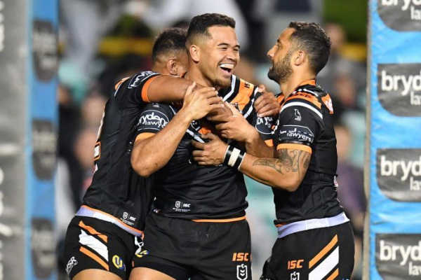 Wests Tigers beat Cowboys to move into NRL top eight