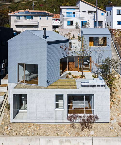 geo-graphic design lab stacks huts on a slope for family residence in takarazuka, japan