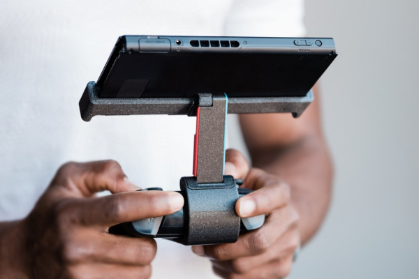 The Fixture S1 gives your Nintendo Switch an ergonomic pro-controller and prop-stand!