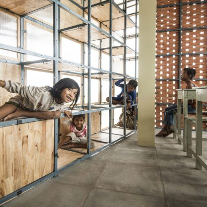 Cambodian school has a gridded facade that doubles as a jungle gym