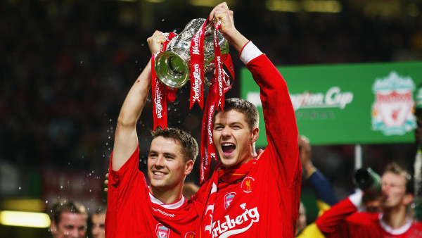 Which players have played for both Manchester United and Liverpool in the Premier League era?