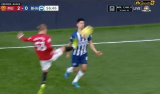 Video: Brandon Williams lucky not to be sent off following AWFUL challenge during Man United vs Brighton
