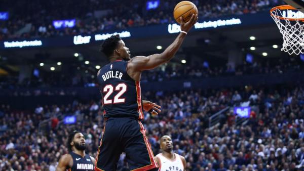 Jimmy Butler's triple-double helps Heat snap Raptors' seven-game win streak