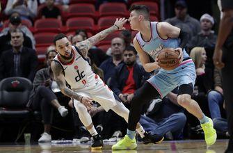Butler's triple-double helps Heat past Wizards, 112-103