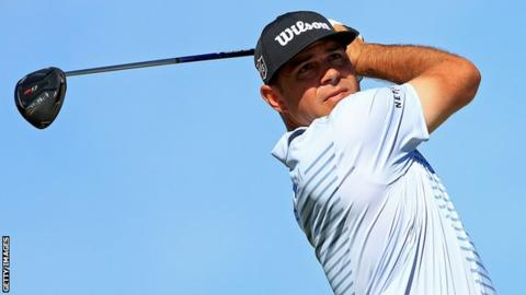 Woods in contention as Reed penalised for breaking rule